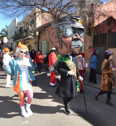 people in costumes walking in a parade
