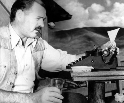 """American novelist and short-story writer Ernest Hemingway is shown at his typewriter as he works on """"For Whom the Bell Tolls"""" at Sun Valley lodge, Idaho, in 1939.  (AP Photo)"""